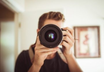 man-photographing-in-domestic-room-360x250.jpg