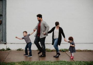 family-of-four-walking-at-the-street-2253879-360x250.jpg