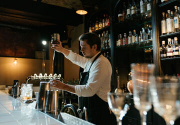 man-in-white-long-sleeve-shirt-pouring-wine-on-clear-wine-4667026-360x250.jpg